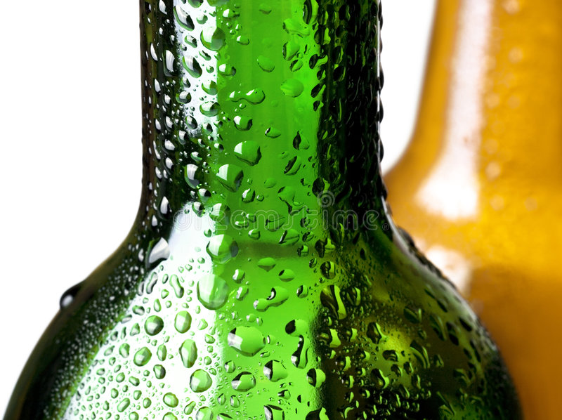Bottle with water drops royalty free stock photography