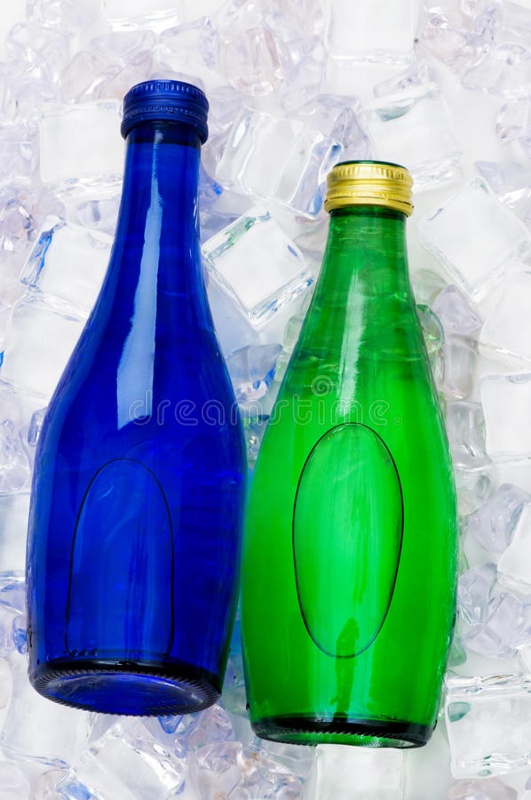 Bottle Of Water On Ice Cubes Stock Image