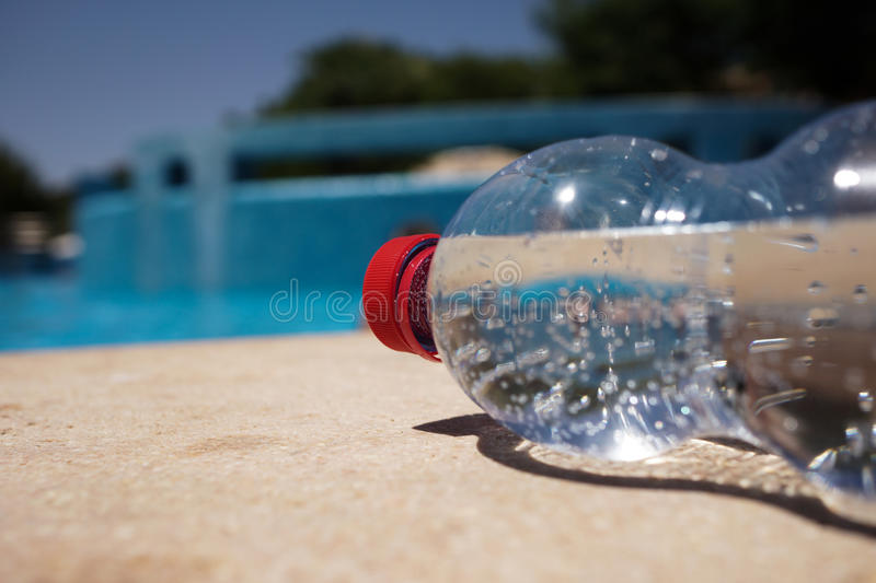 Download Bottle Of Water On Poolside Stock Image - Image: 27412909