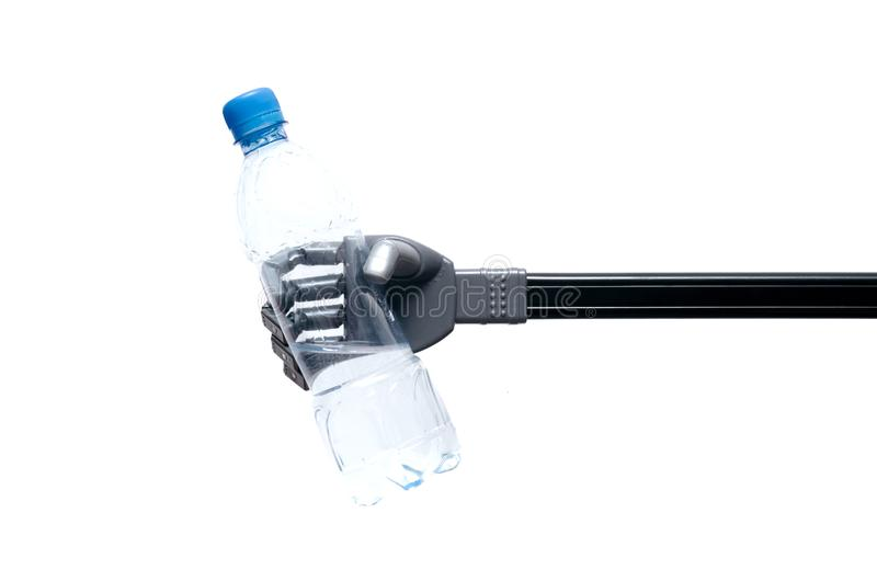 Bottle of water in the robot hand. Toy robot hand is holding a bottle of water or petrol isolated on white background royalty free stock photography