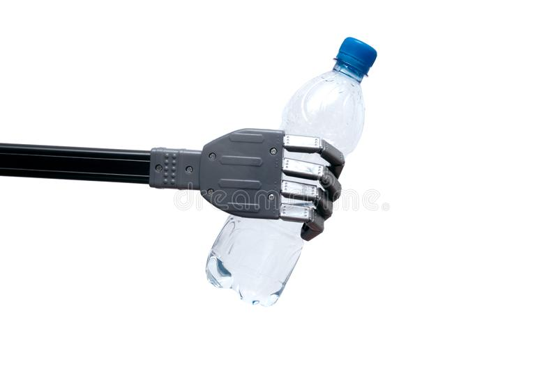 Bottle of water in the robotic arm. stock image