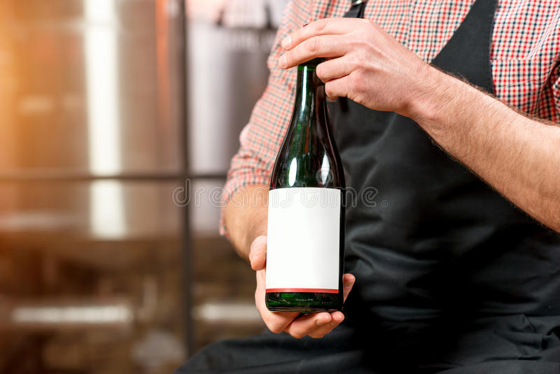 Bottle of wine or beer at the manufacturing royalty free stock images