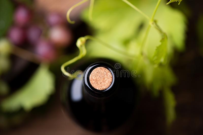A bottle wine close up with a cork. royalty free stock images
