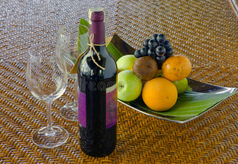 Bottle of wine, fruits and glasses on the table stock image