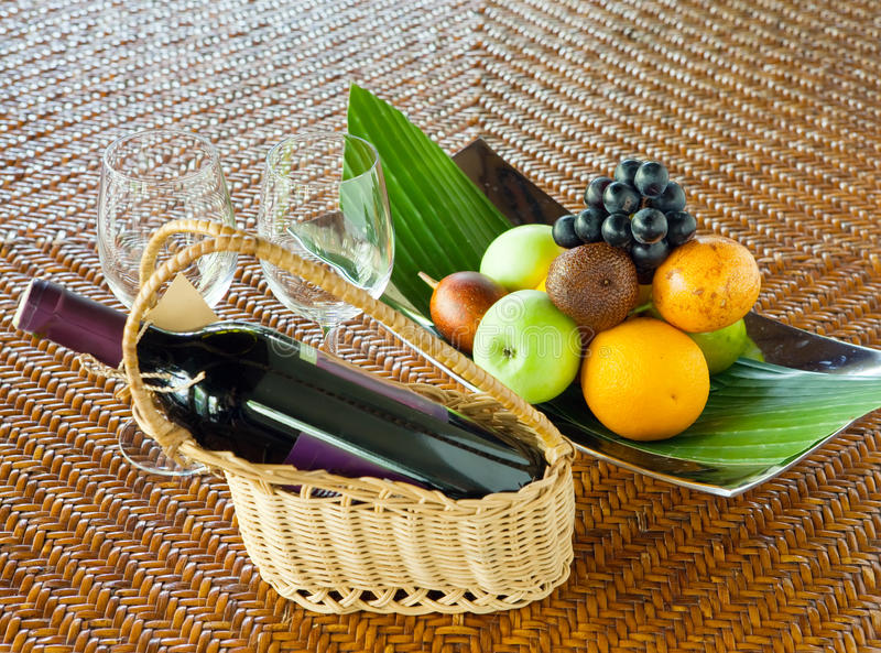 Bottle of wine, fruits and glasses on the table stock photography