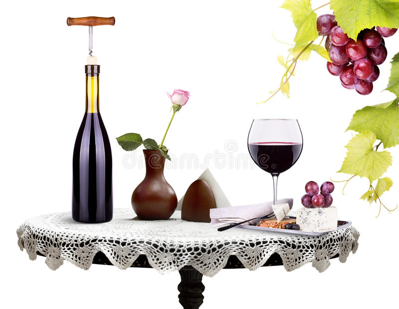 Bottle, wine glass with flower and food on a table. Isolated on a white background stock photos