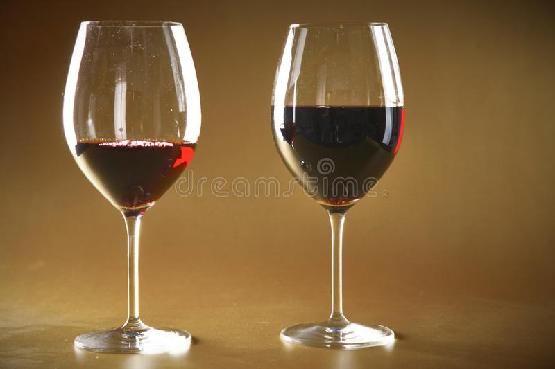 Bottle of wine and glass on the table stock photos