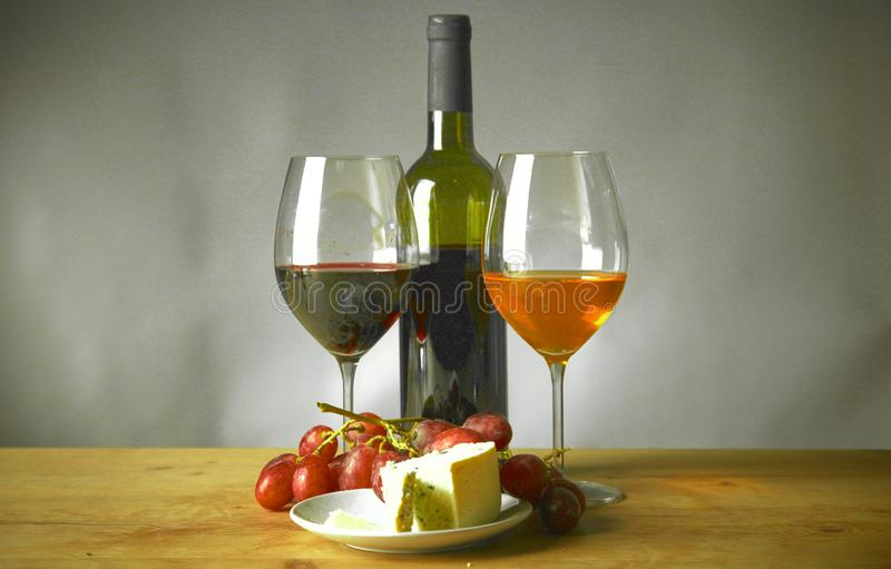 Bottle of wine and glass on the table stock photography