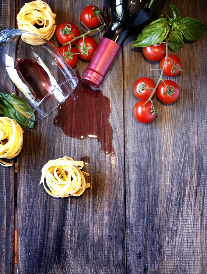 Bottle of wine, glass, tomatoes and pasta stock photos