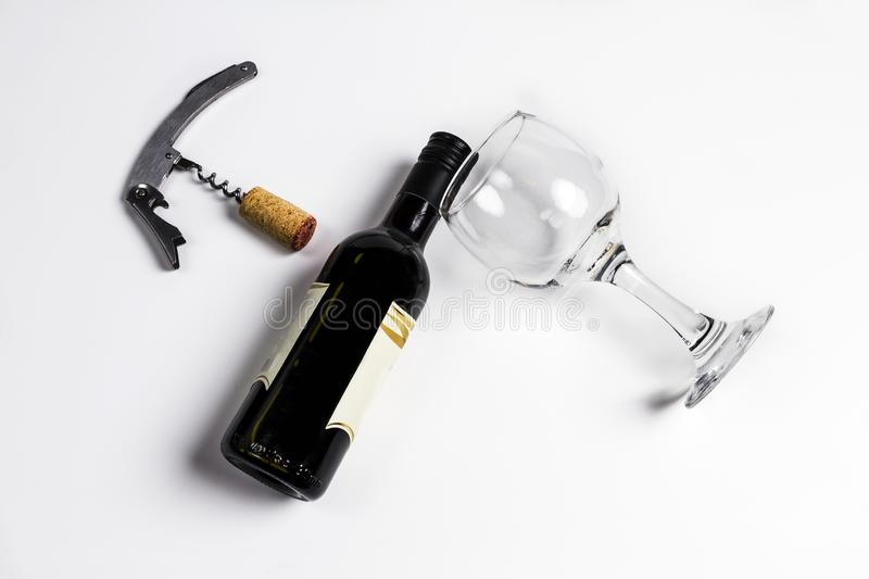 Bottle of wine with glasses and corkscrew. On white isolated background stock photography