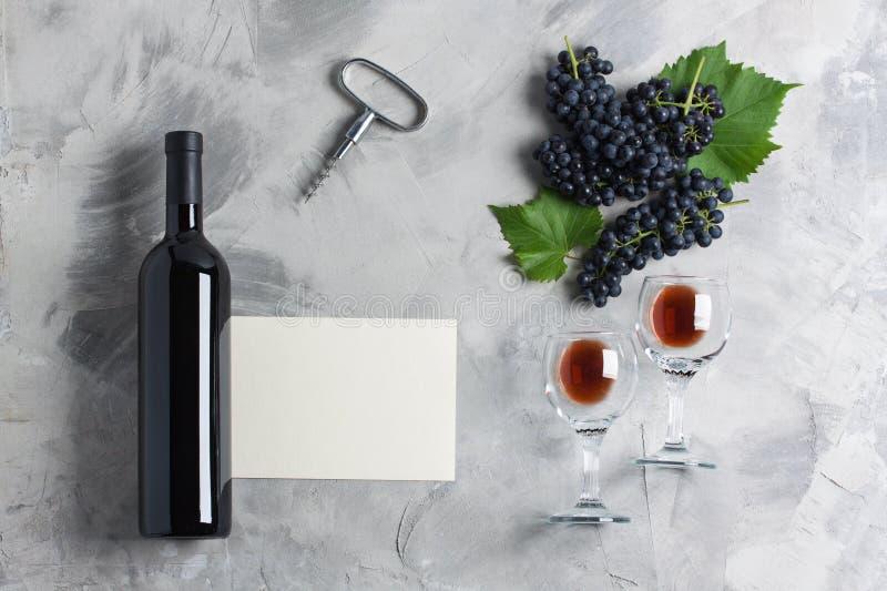 Bottle of wine glasses grape corkscrew empty card mockup royalty free stock photos