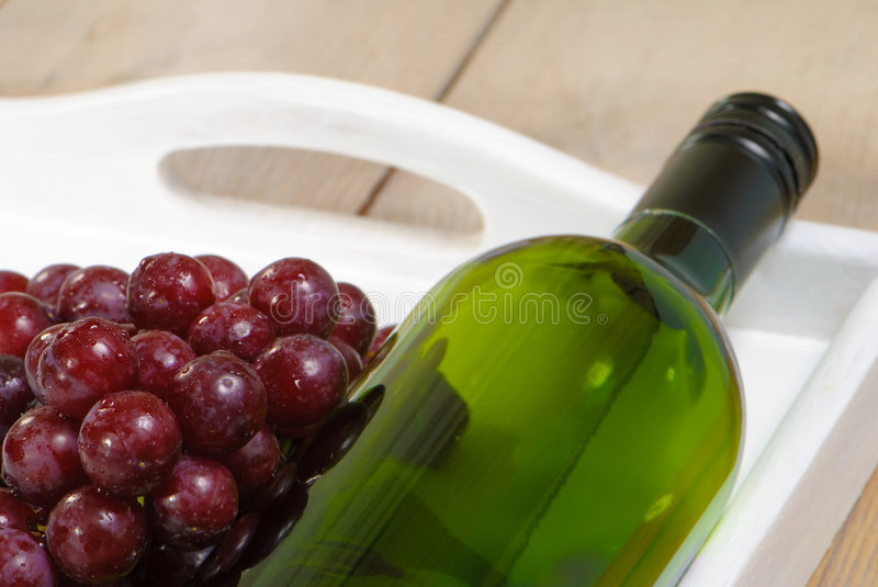 Bottle Of Wine With Grapes stock photography