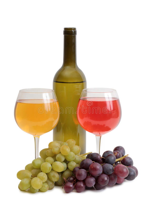 Bottle wine and grapes on white stock photography