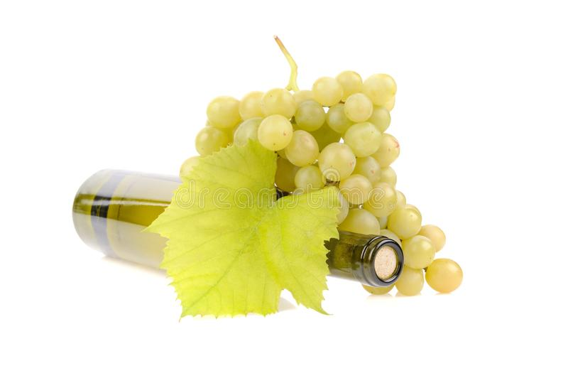 Bottle of wine with green grapes. Alcohol, background, bar, beverage, blank, cabernet, celebration, clean, clear, drink, elegance, food, full, glass, glasses royalty free stock images