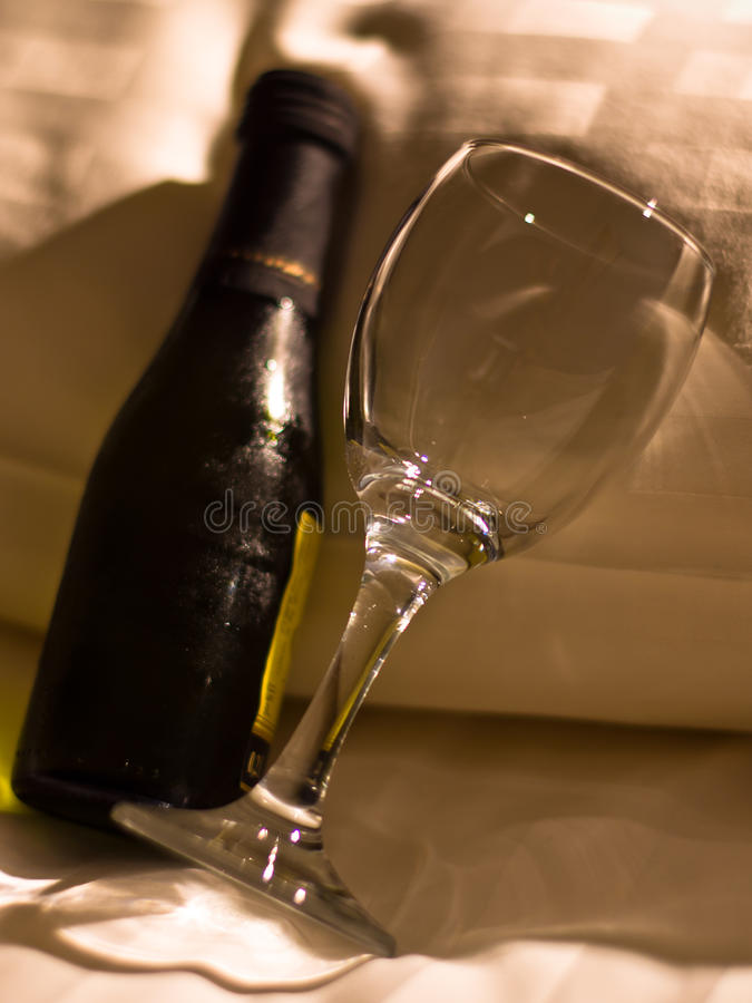 Download Bottle of wine on a pillow stock image. Image of interior - 27164939