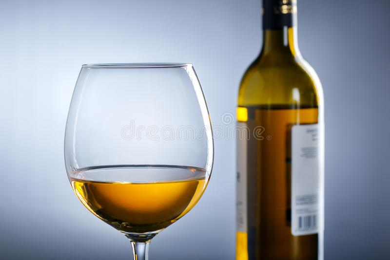 Bottle of wine and wine glass royalty free stock image