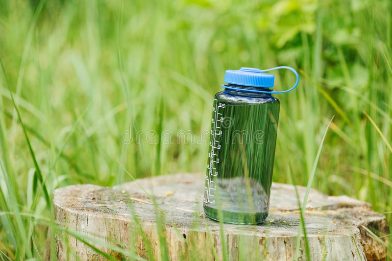 Bottle on wood with summer scene background stock photos
