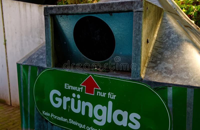Bottlebank from Germany with instructions such as the Bottlebank must be filled to clarify the recycling of raw materials.  stock image