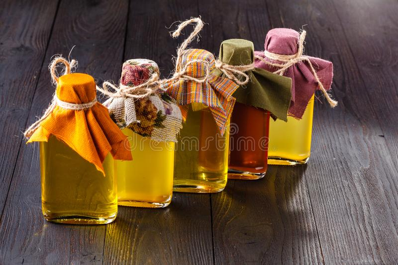 Bottled different virgin oil in small glass jars royalty free stock photos