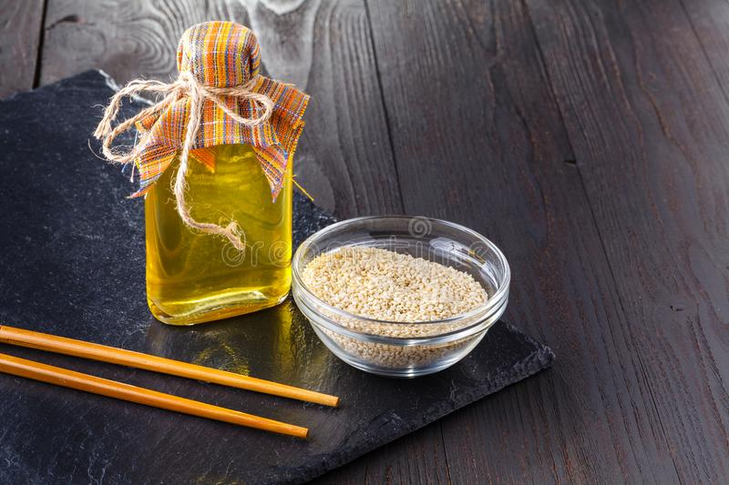 Bottled different virgin oil in small glass jars royalty free stock image