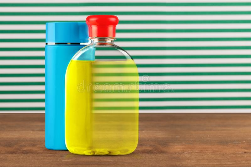 Bottled Lotions. Plastic Spray Protection Merchandise Group of Objects White Background stock photography