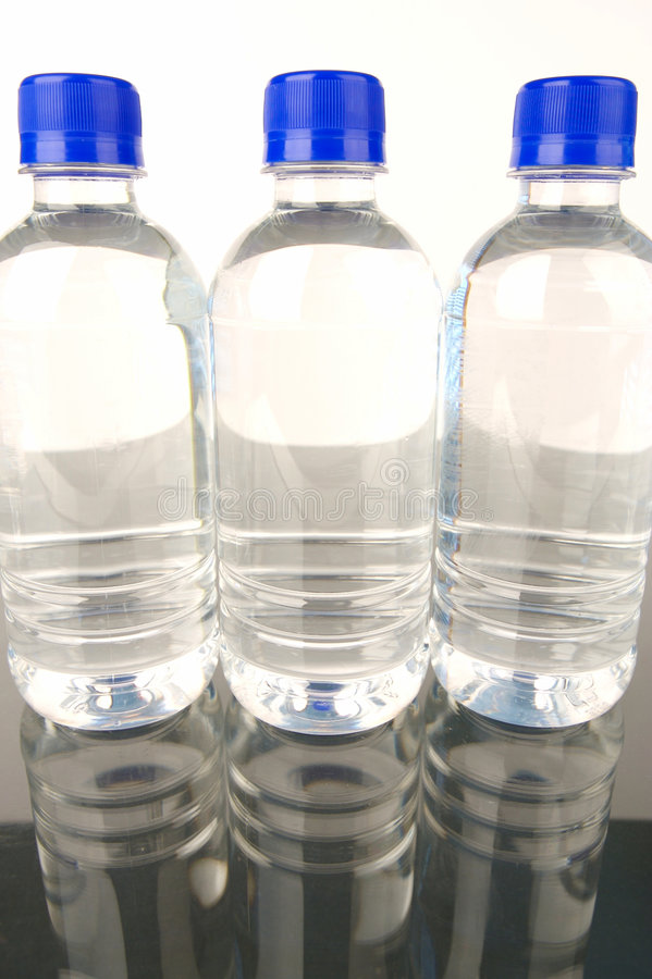 Bottled Water. Isolated against a green background stock images