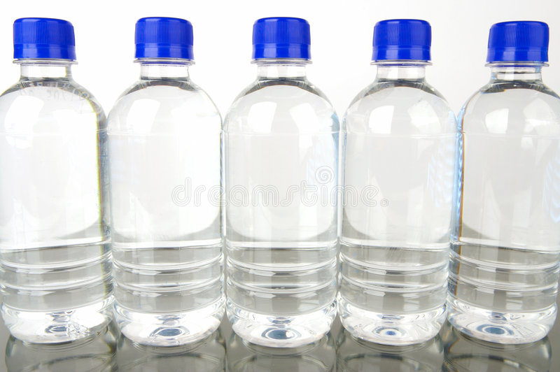 Bottled Water. Isolated against a background stock images