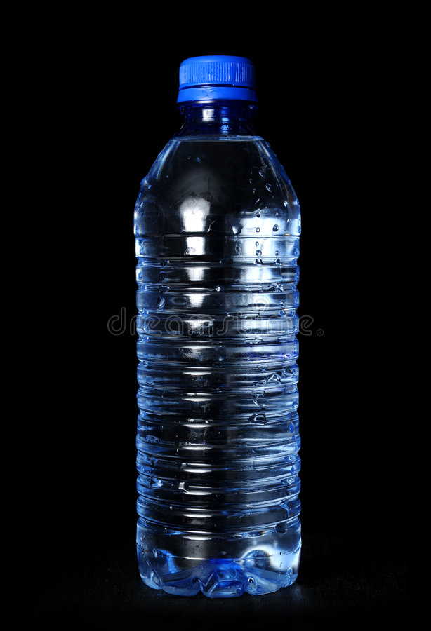 Bottled Water on Black Background. Bottled water with droplets over a black background royalty free stock photography