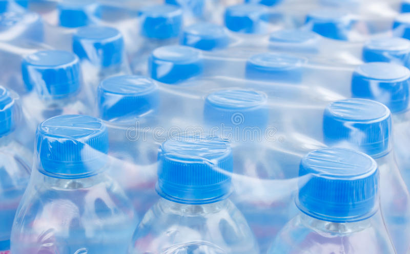 Bottled water bottles in plastic wrap royalty free stock images