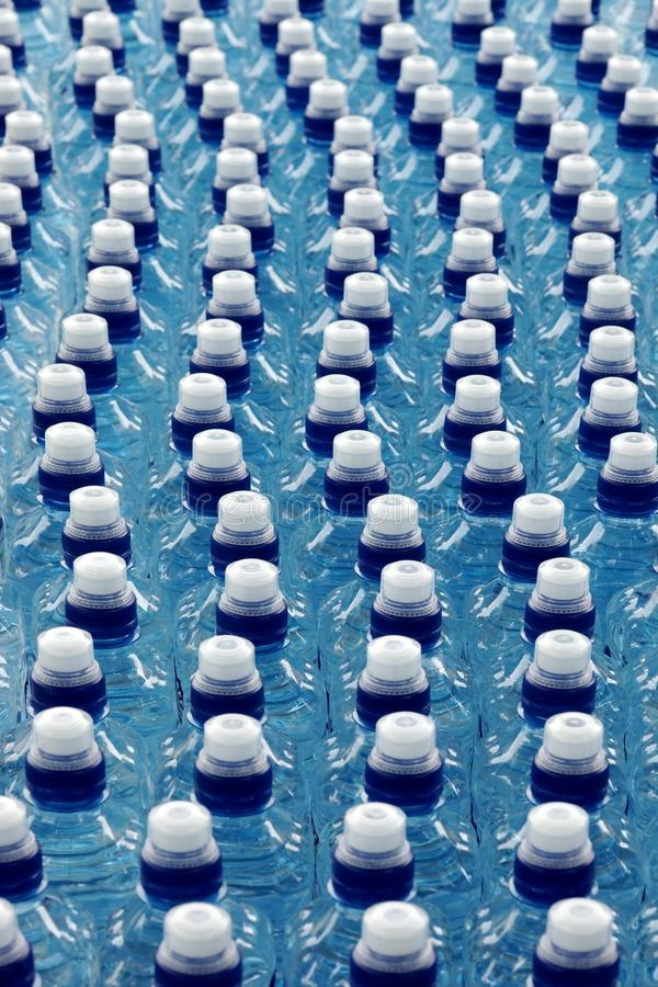 Bottled Water In A Row On The Outdoor Party Table. Close-up Background Texture stock photo