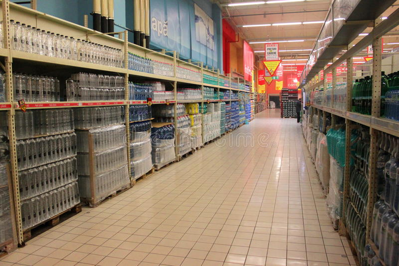 Bottled water in a supermarket. Bottled water for sale in a supermarket Cora, Bicharest, Romania stock photography
