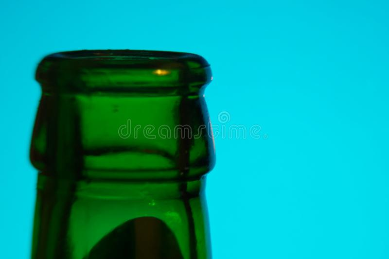 Bottleneck in green color, Empty close-up Bottle, Detox Concept. Abstinence, Alcoholism Treatment. New Year's Resolutions. Becoming A New You, Promising A stock photography