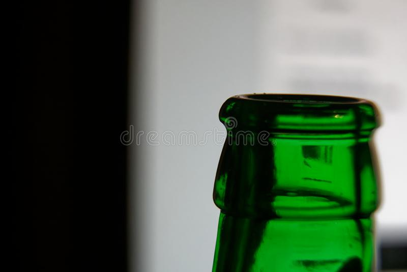 Bottleneck in green color, Empty close-up Bottle. Detox Concept. Abstinence, Alcoholism Treatment. New Years Resolutions. Becoming A New You, Promising A royalty free stock image