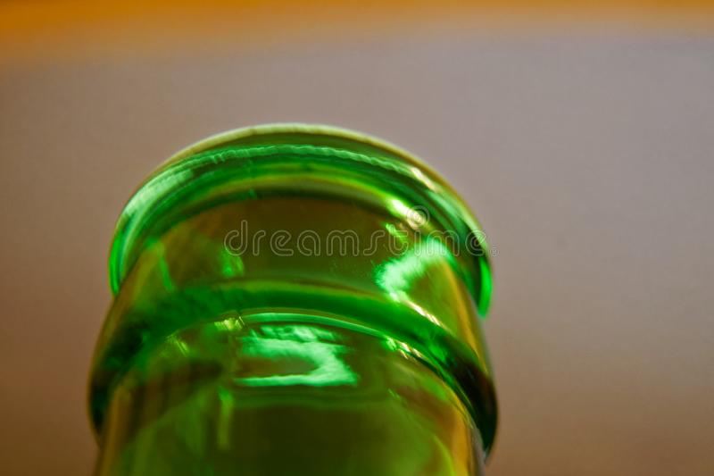 Bottleneck in green color, Empty close-up Bottle. Detox Concept. Abstinence, Alcoholism Treatment. New Years Resolutions. Becoming A New You, Promising A royalty free stock photo