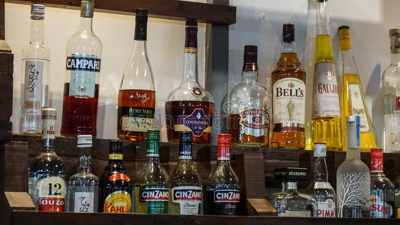 Bottles of alcohol in a bar in Cyprus. Drink drinking glass label capacity Tara exhibition choice stock photography