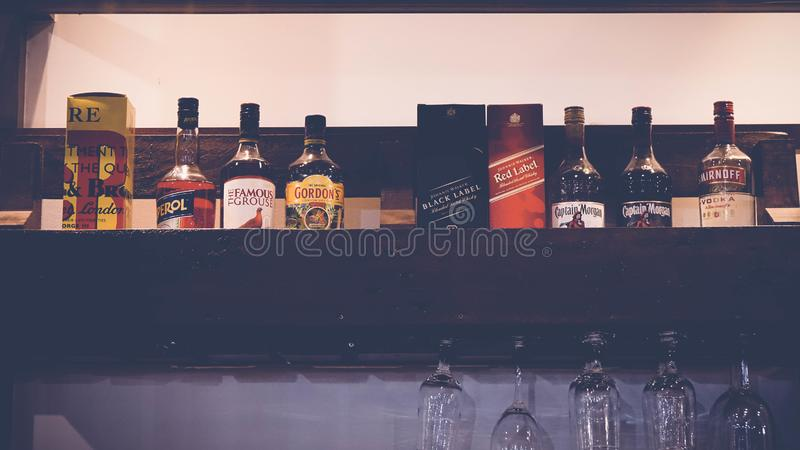 Bottles with alcohol bar drinks. Glass packaging label background stock photo