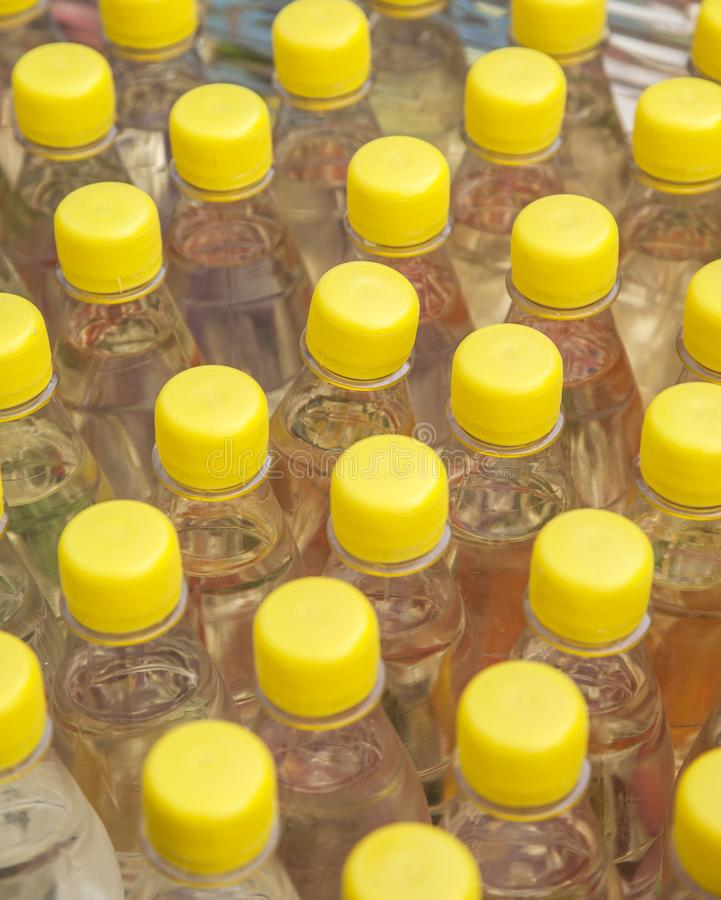 Bottles with alcohol. Several yellow bottles with alcohol stock photography