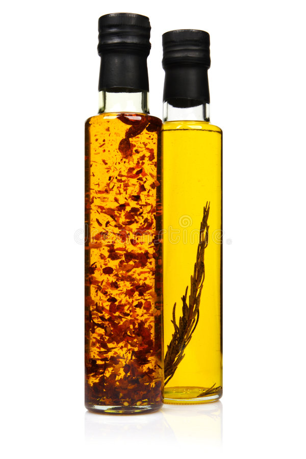 Bottles of aromatic olive oil. Bottles of aromatic olive oil with rosemary and chilli pepper stock photography