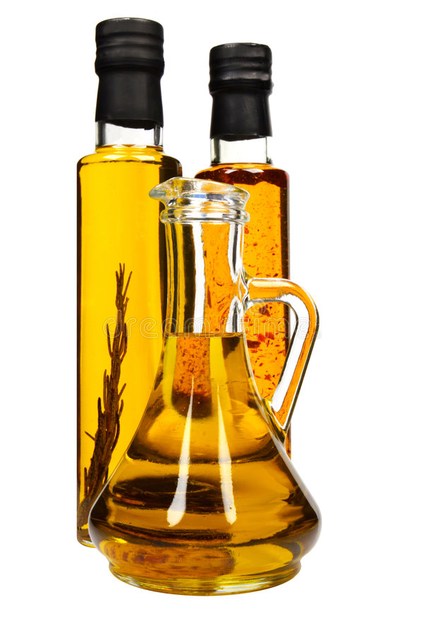 Bottles of aromatic olive oil. Bottles of aromatic olive oil with rosemary, chilli pepper and pure olive oil stock photos