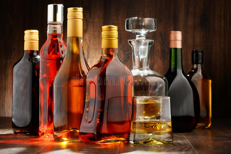 Bottles of assorted alcoholic beverages. Composition with bottles of assorted alcoholic beverages stock images