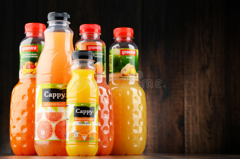 Bottles of assorted fruit juices. POZNAN, POLAND - JAN 18, 2017: Fruit juice consumption overall in Europe, Australia, New Zealand and the US has increased in royalty free stock photos