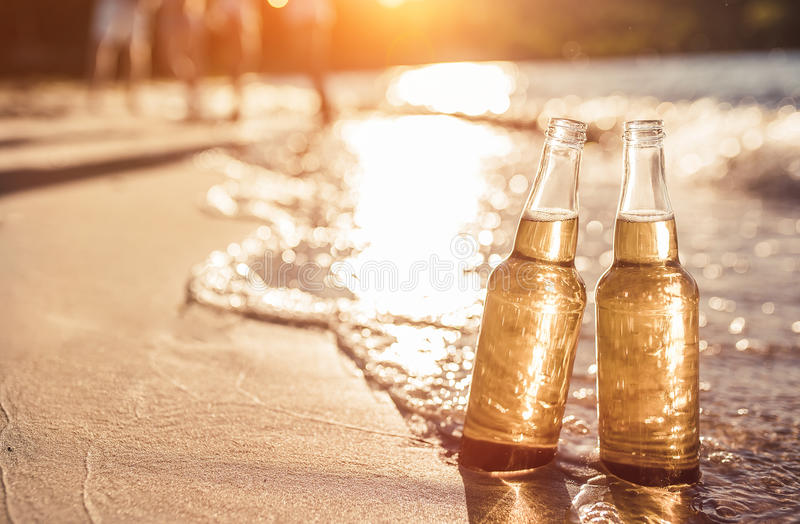 Bottles of beer on the beach stock photo