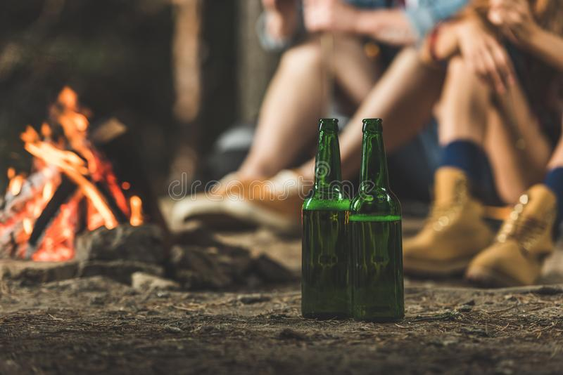Bottles of beer in hiking camp next. To bonfire royalty free stock image
