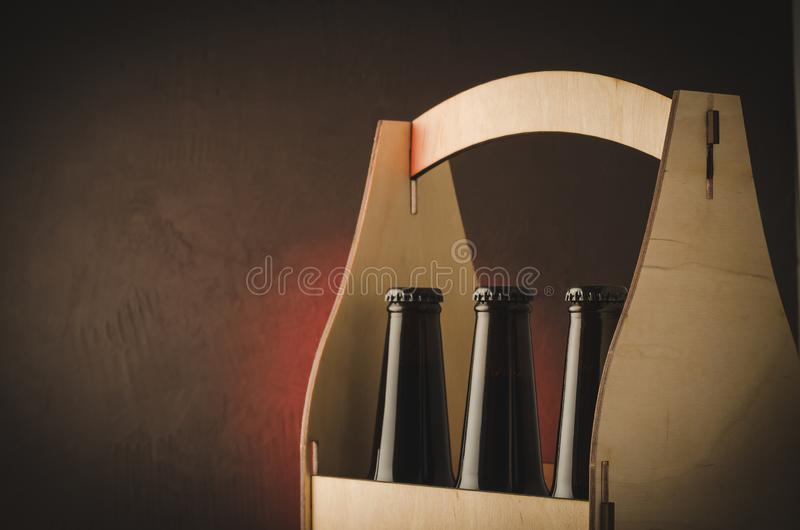Bottles of beer in a wooden case/bottles of beer in a wooden case. Selective focus and copyspace royalty free stock photo