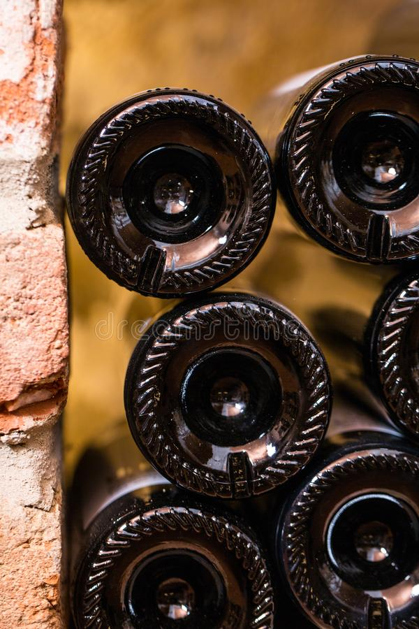 Many Bottles between red bricks - backside royalty free stock photo
