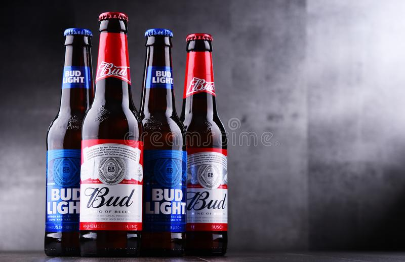 Bottles of Bud and Bud Light beer. POZNAN, POL - MAY 3, 2018: Bottles of Bud and Bud Light, popular American beers, produced by Anheuser-Busch stock photos