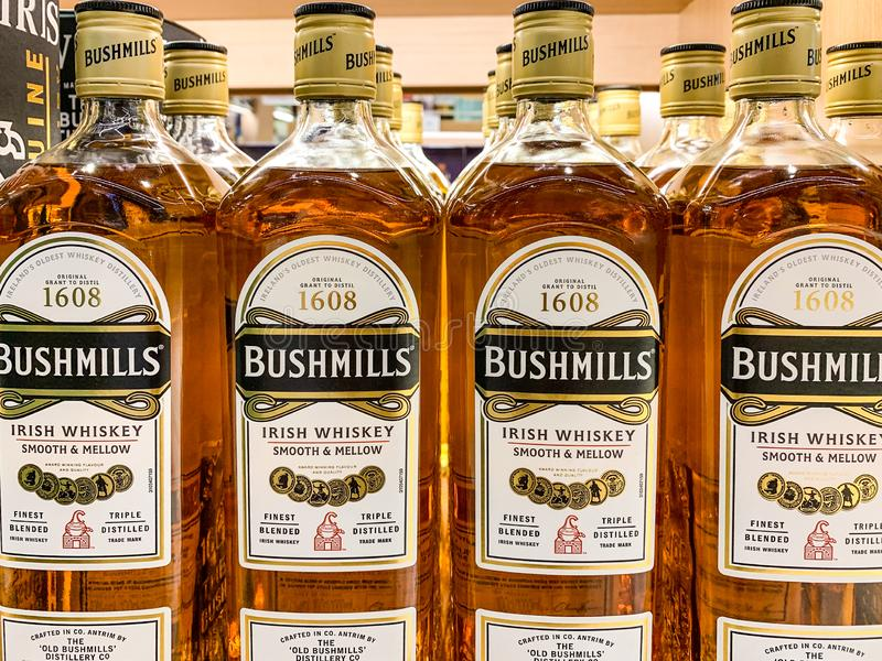 Bottles of Bushmills on display in a shop. The Old Bushmills Distillery is a whiskey distillery in Bushmills, County Antrim,. Northern Ireland. Istanbul/ Turkey stock images
