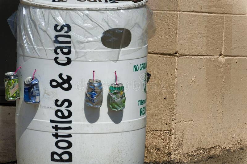 Bottles & cans recycling barrel stock photos