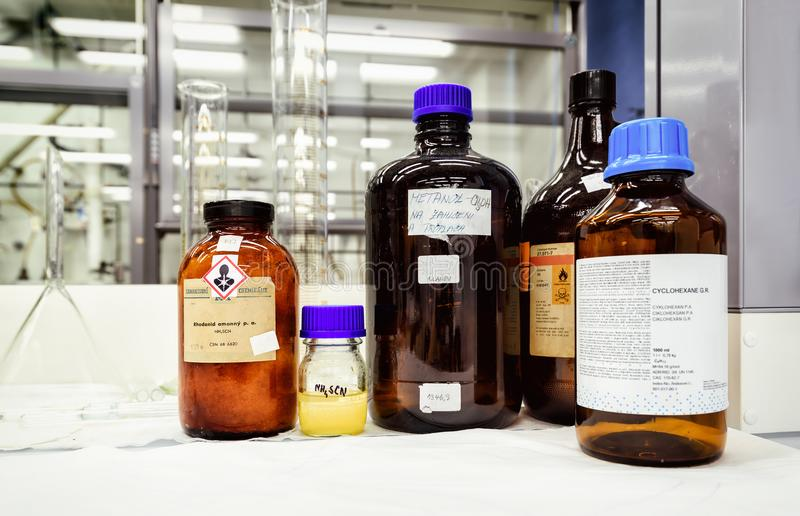 Bottles with chemicals on the desk in laboratory royalty free stock photo