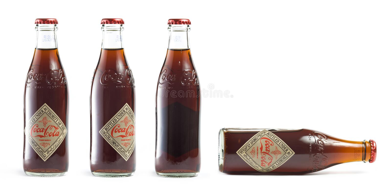 bottles cocaen - colatappning royaltyfria foton